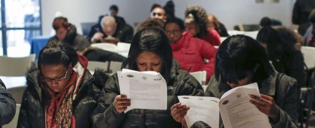 People fill out application forms before a screening session for seasonal jobs at Coney Island in the Brooklyn borough of New York on March 4, 2014.SHANNON STAPLETON/REUTERS